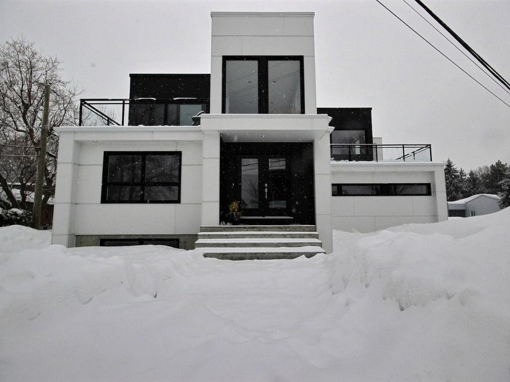 Découvrez cette nouvelle réalisation; une magnifique résidence de style moderne et épuré. Visitez sans tarder lintérieur de cette nouvelle construction qui