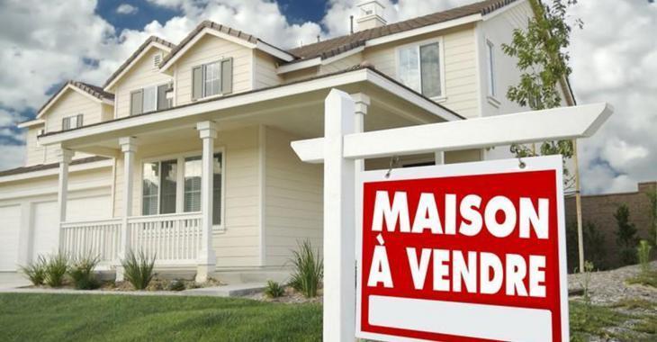 Elle doit payer une amende pour un panneau «À vendre» devant sa maison