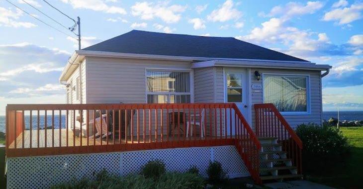Maison meublée avec vue sur le fleuve à moins de 80 000 $